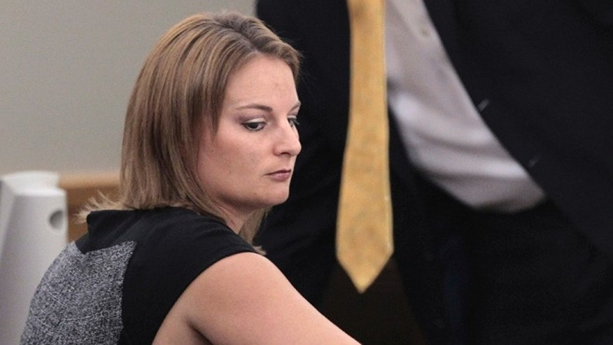 Aug. 14, 2012: Brittni Colleps sits in the courtroom during a break in her trial in Fort Worth, Texas.