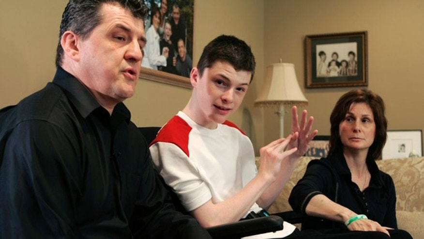 FILE 2008: Steven Domalewski, center, sits with his parents Joseph and Nancy Domalewski during an interview at their home in Wayne, N.J.