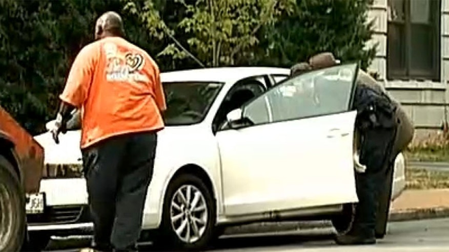 Aug. 18, 2012: Investigators examine the car where Megan Boken was shot to death.