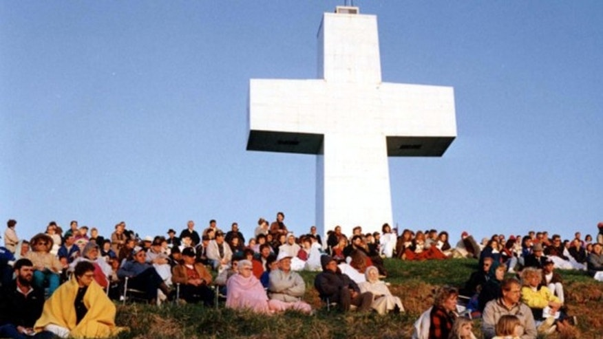 Christians rally to show support of the Bald Knob Cross of Peace near Alto Pass, Ill. Atheists objected to the use of taxpayer money to pay for rehabbing the 11-foot cross. (AP)