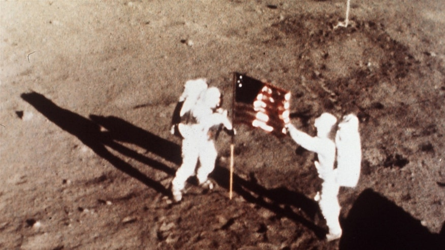 "July 20, 1969: Apollo 11 astronauts Neil Armstrong and Edwin E. ""Buzz"" Aldrin, the first men to land on the moon, plant the U.S. flag on the lunar surface."