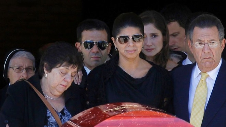 Aug. 29, 2012: Ivette Rivera, center, fiancee of Empire State Building shooting victim Steve Ercolino, is flanked by the victim&#39&#x3b;s parents, Rosalie and Frank Ercolino, as they follow the coffin out after a funeral mass at Our Lady of Sorrows church in White Plains, N.Y.