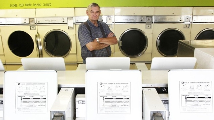 Aug. 10, 2012: Richard Eggars stands in a laundromat in Carlisle, Iowa that has come back to haunt him.