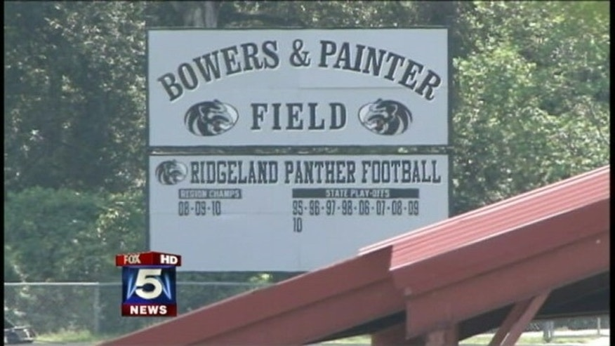 School officials rally around Ridgeland High School football coach.