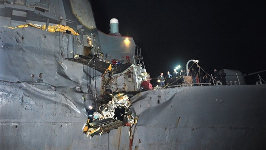 Aug. 12, 2012: In this image released by the U.S. Navy, the U.S. Navy's guided-missile destroyer is seen damaged after it collided with a Japanese-owned oil tanker just outside the strategic Strait of Hormuz.