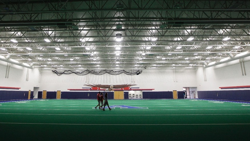 Aug. 28, 2012: Students walk across the indoor practice field that is part of the new  $60 million football stadium at Allen High School in Allen, Texas.