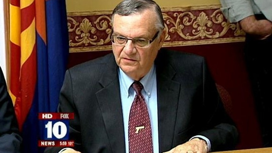 FILE: Federal authorities say they're closing their abuse-of-power investigation into Maricopa County Sheriff Joe Arpaio in Arizona without filing charges against him.