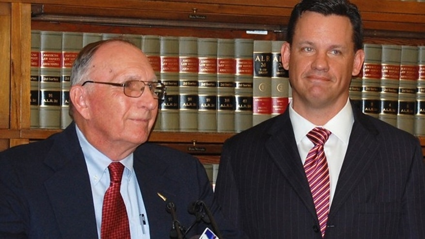 Aug. 31: Darrell Parker, left, speaks at a news conference with Nebraska Attorney Gen. Jon Bruning, right, in the Attorney General's office in the Capitol in Lincoln.