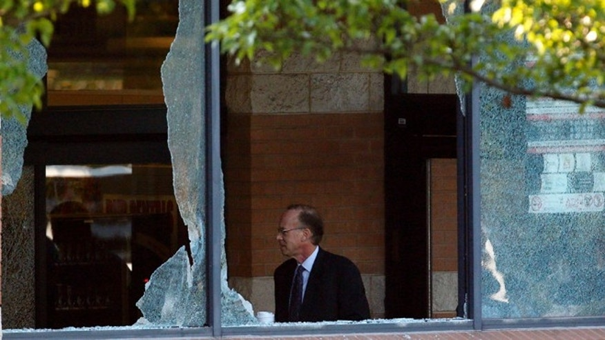 Aug. 31, 2012: Middlesex County prosecutor Bruce Kaplan inspects the scene of a shooting at a Pathmark grocery store in Old Bridge, N.J.