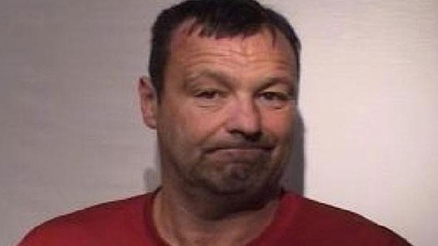 David Howard is accused of trying to push two boys in front of a train.