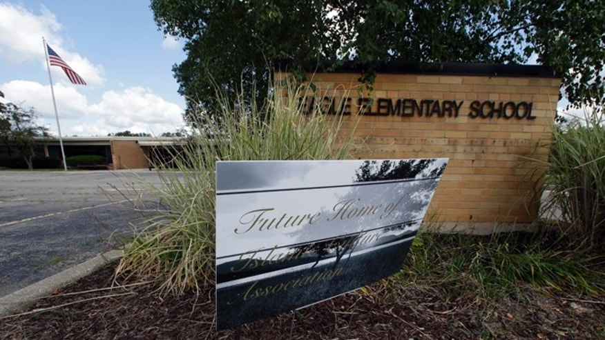 Aug. 29, 2012: A sign for the future home of Islamic Culture Association is shown outside the former Eagle Elementary School in West Bloomfield, Mich.