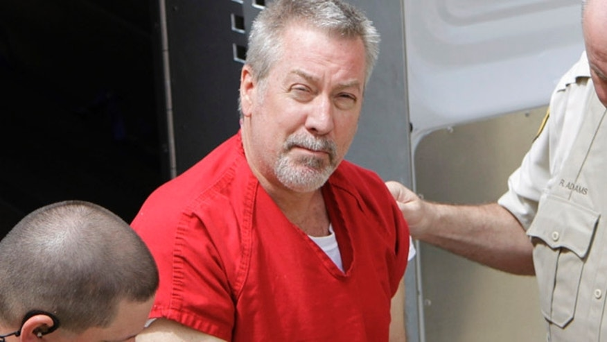 "Drew Peterson, seen here in 2009, was convicted last year of killing his third wife, but that didn't stop three male pen pals from reportedly contacting the former cop. ""Not only are they writing him letters, but they are putting money into his prison spending account so he can buy extra food for himself in the prison commissary like Skittles and popcorn,"" a source close to Peterson told the Chicago Sun-Times last year. (AP)"