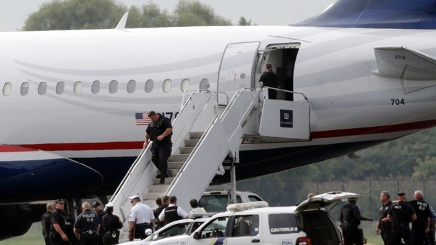 Sept. 6, 2012: Law enforcement officials work around a US Airways flight at Philadelphia International Airport, after the plane returned to the airport.