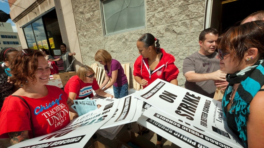 Sept. 8, 2012: Members of the Chicago Teachers Union distribute strike signage at the Chicago Teachers Union strike headquarters.
