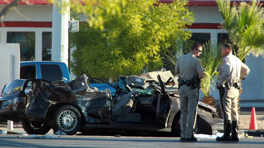 Sept. 13, 2012: Police officers stands near a vehicle involved in a crash at a bus stop.