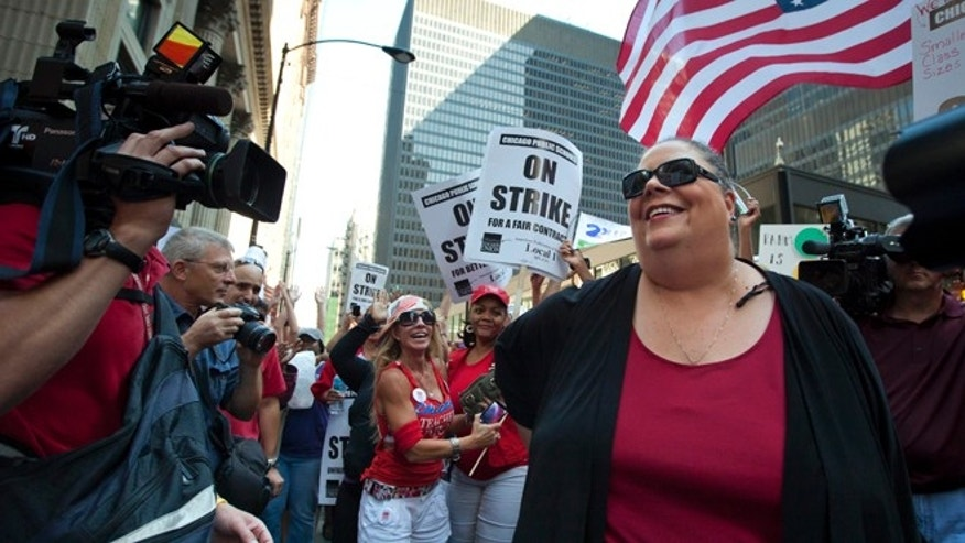 Chicago Teachers Union President Karen Lewis takes a break from negotiations with the Chicago Board of Education to make an unexpected appearance at a rally of thousands of public school teachers on Tuesday, Sept. 11, 2012 in Chicago. Teachers walked off the job Monday for the first time in 25 years over issues that include pay raises, classroom conditions, job security and teacher evaluations. (AP Photo/Sitthixay Ditthavong)