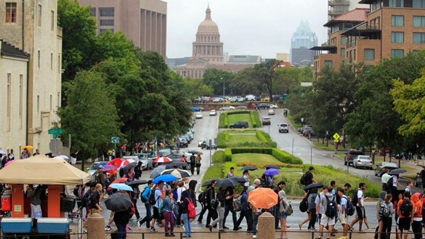 Sept. 14, 2012: University of Texas students evacuate campus after the university received a bomb threat Friday morning in Austin, Texas. The university received a call about 8:35 a.m. local time from a man claiming to be with Al Qaeda who said he had placed bombs all over the 50,000-student campus, according to University of Texas spokeswoman Rhonda Weldon. (AP)