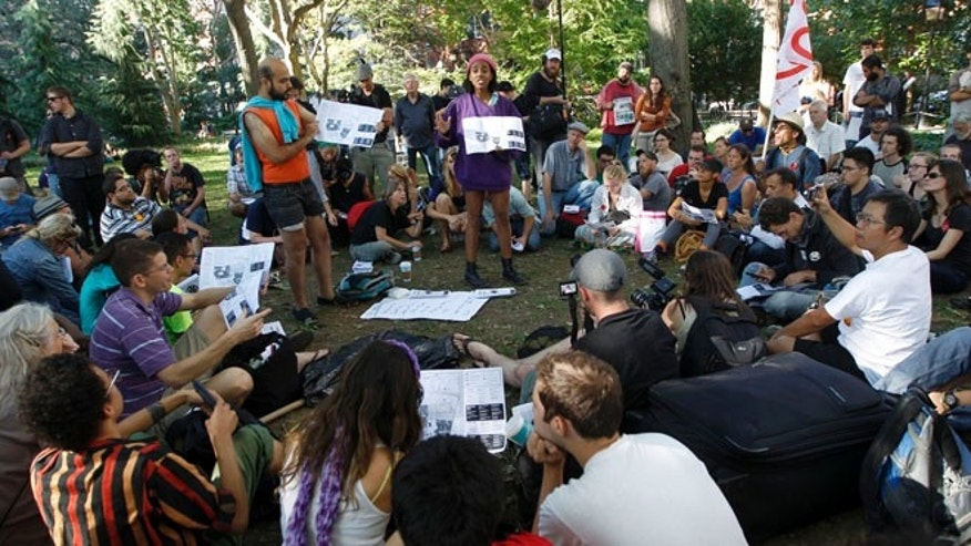 Sept. 15, 2012: Activist associated with the Occupy Wall Street movement participate in a general assembly during a gathering of the movement in Washington Square park in New York.