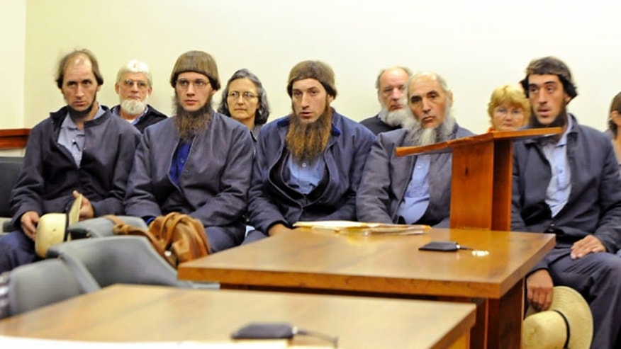 Oct. 19, 201: From left, Johnny Mullet, Lester Mullet, Daniel Mullet, Levi Miller and Eli Miller wait to make their pleas in Holmes County Municipal Court in Millersburg, Ohio, in the case involving beard- and hair-cutting attacks against Amish men and women in Ohio. Sam Mullet Sr. and 15 other Amish men and women are to go on trial Monday in Cleveland on charges of carrying out hate crimes in the hair-cutting attacks. Other charges include conspiracy, evidence tampering and obstruction of justice in what prosecutors say crimes motivated by religious differences. They could face lengthy prison terms if convicted. (AP)