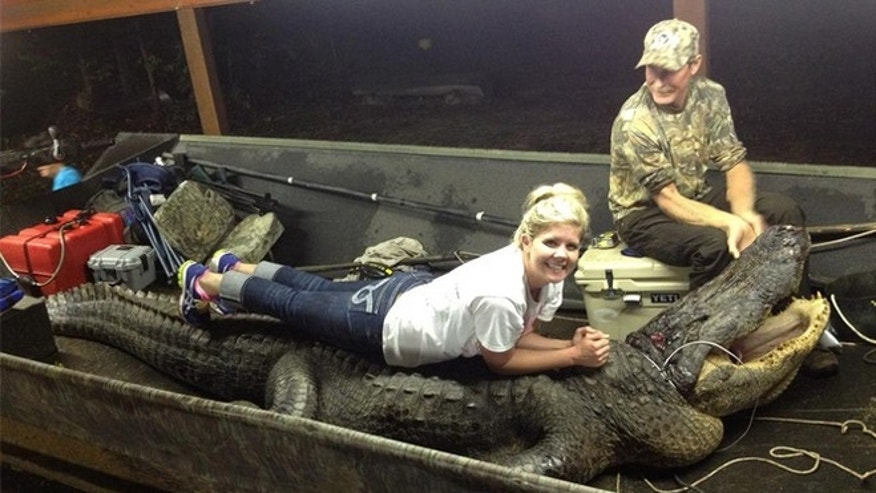 Mike Cottingham, his daughter Cassie and the giant gator.