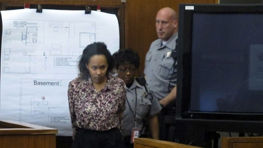 Sept. 19, 2012: Bailiffs lead Annette Morales-Rodriguez into Milwaukee County court for the second day of her trial on charges that she killed a pregnant woman last year and tried to steal her full-term fetus.