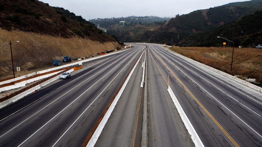"July 16, 2011: File photo shows Interstate 405 free of traffic, seen looking south from the Skirball Drive bridge, as the demolition of two lanes Mulholland Drive bridge continue in Los Angeles at dawn. ""Carmageddon II: The Sequel"" is coming to one of the nation's most crowded freeways later in Sept. 2012, and this time authorities are hoping the event's subtitle won't be, ""The Traffic Strikes Back."""