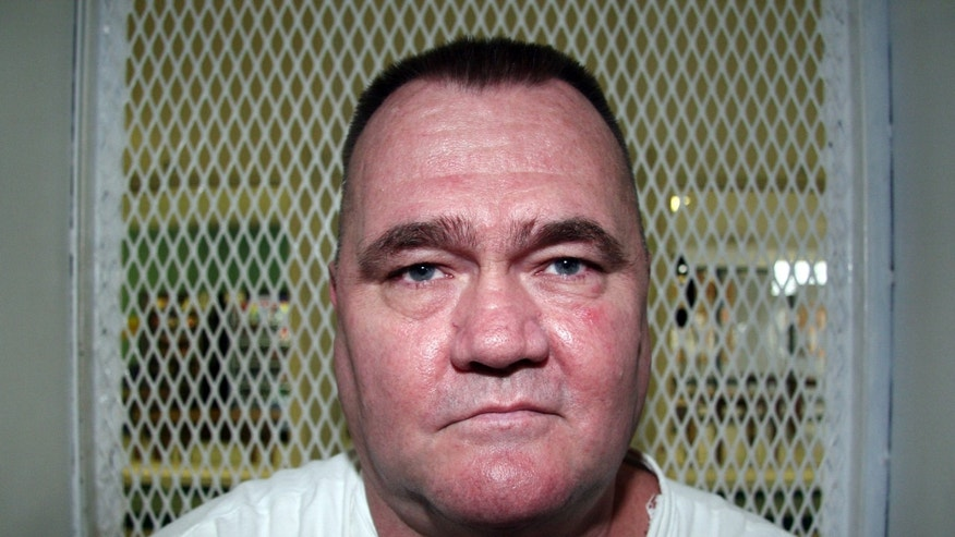 Aug. 29, 2012: In this photo, convicted killer Cleve Foster speaks from a visiting cage at the Texas Department of Criminal Justice Polunsky Unit outside Livingston, Texas.