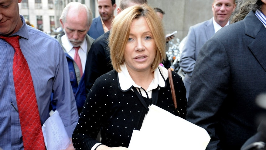 Sept. 25, 2012: Anna Gristina exits Manhattan criminal court in New York.The suburban mother of four charged with moonlighting as a multimillion-dollar madam pleaded guilty Tuesday to promoting prostitution.