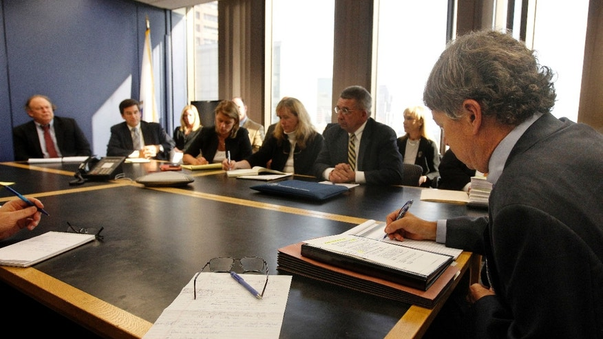 Sept. 24, 2012: David Meier, right, special consul to the Governor appointed to lead the review of drug convictions which might have been compromised by a State Police drug testing lab, leads a meeting at the Department of Public Safety in Boston.