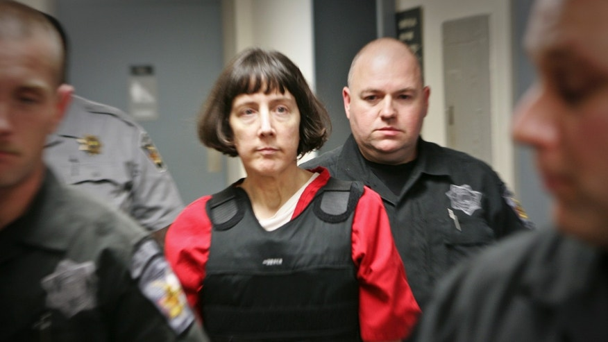 Sept. 11, 2012: Amy Bishop is escorted by sheriff's deputies at the Madison County Courthouse in Hunstville, Ala.