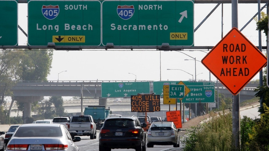 Sept. 26, 2012: A message board flashes a warning to drivers on Interstate 10, the Santa Monica Freeway in West Los Angeles, to plan for the two-day closure of the Interstate 405 freeway over the Sepulveda Pass this coming weekend, Sept. 29-30.