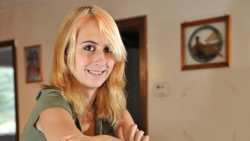 This Sept. 19, 2012 photo shows Whitney Kropp at her home in Alger, Mich.