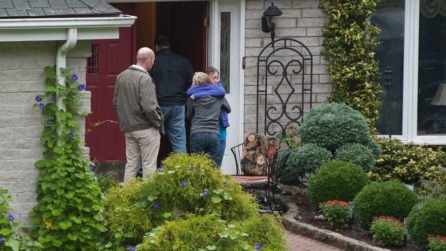 Sept. 28, 2012: Visitors arrive at the home of Jeffrey Giuliano in New Fairfield, Conn. Giuliano fatally shot a masked teenager in self-defense during what appeared to be an attempted burglary early Thursday morning, then discovered that he had killed his son, Tyler, state police said.