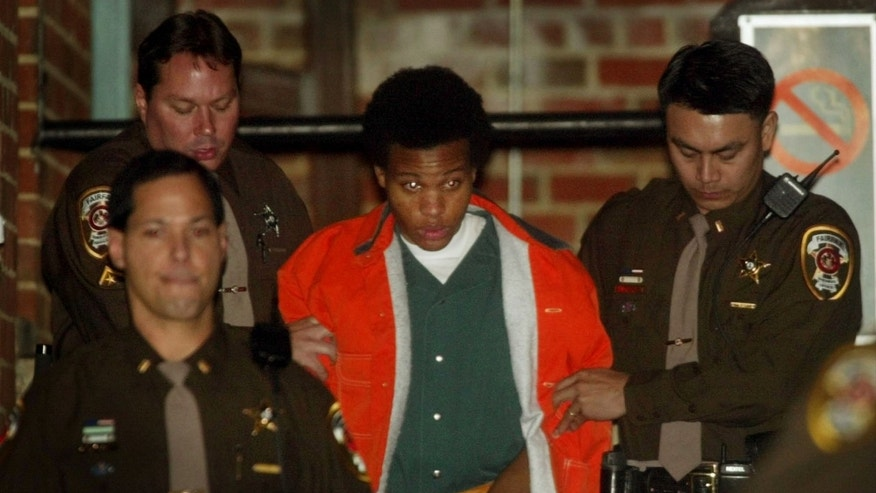 FILE: Lee Boyd Malvo is escorted from court after his preliminary hearing in Fairfax, Va.