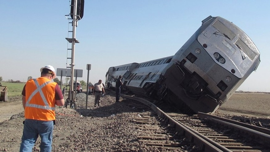 Oct. 1, 2012: Emergency personnel respond to the scene of a train derailment in Hanford, Calif.