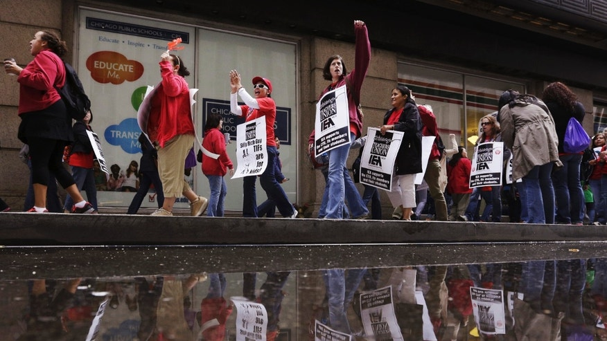 Sept. 18, 2012: File photo; Chicago Teachers Union members strike outside the Chicago Public Schools headquarters in Chicago.