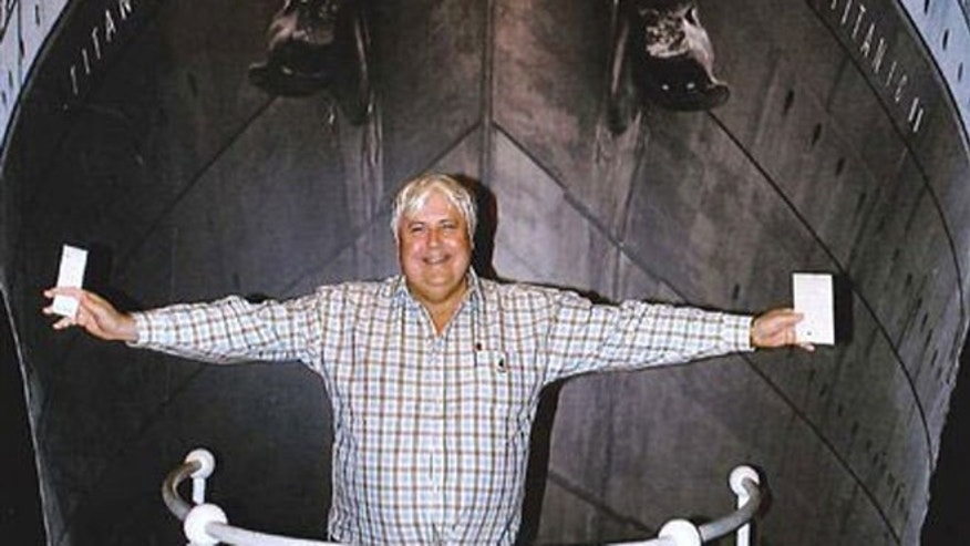 April 25, 2012: In this photo provided by Crook Publicity, Australian billionaire Clive Palmer poses in front of an artist impression of the Titanic ll at MGM Studios in Los Angeles, Ca.