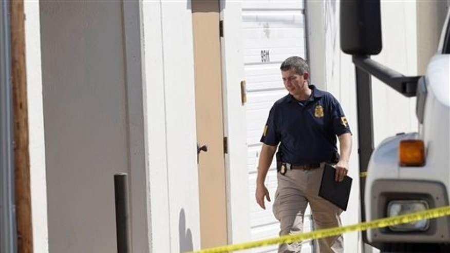 Oct. 3, 2012: An FBI agent enters Arc Electronics Inc. in Houston.