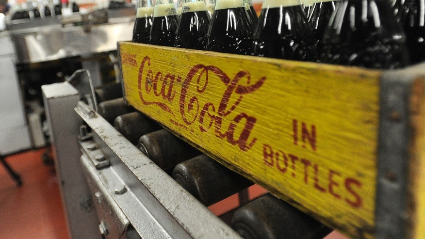 Oct. 9, 2012: Bottles in the last run are prepared for crates at the Coca-Cola Bottling Company in Winona, Minn.