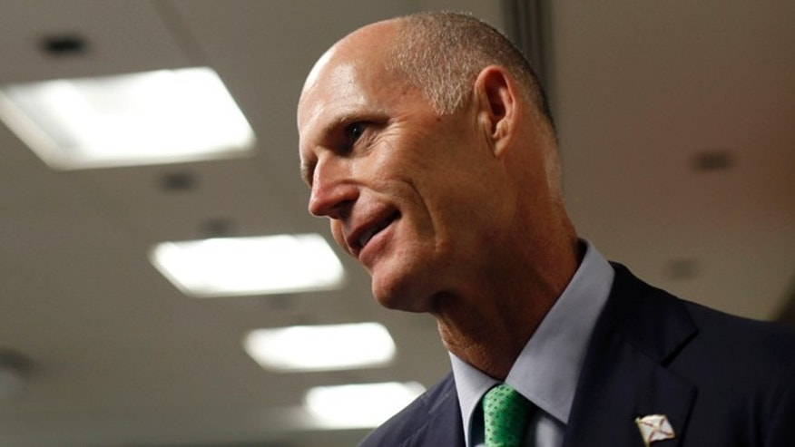 FILE: Florida governor Rick Scott gave out an incorrect phone number to residents concerned about recent meningitis scare