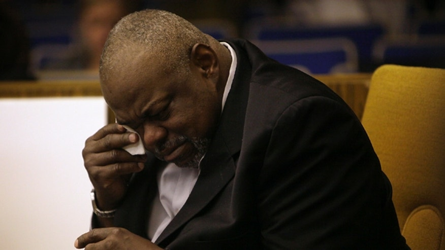 March 6, 2012: Grafton Peterson, father of the late Erin Peterson wipes away a tear after a photo of his daughter was shown to the jury during the wrongful death trial against the Commonwealth of Virginia and Virginia Tech at the Montgomery Circuit Court in Christiansburg, Va.