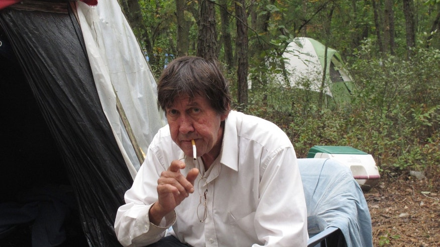 Oct. 4, 2012 - Douglas Hardman prepares to light a cigarette outside the teepee in which he lives in an encampment of homeless people in Lakewood N.J.