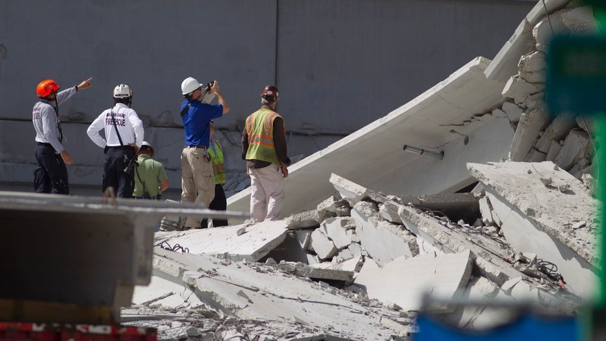 Oct. 11, 2012 - Rescue officials survey damage in the collapsed parking garage at the Miami Dade College West campus in Doral, Florida