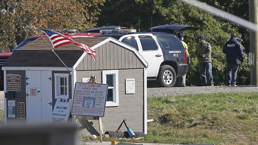 Oct. 13, 2012: Officials search for a body on Peirce Island in Portsmouth, N.H. (AP)