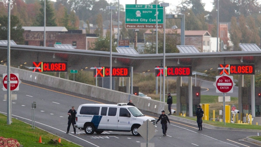 Oct. 16: 2012: United States border agents work at the closed Surrey, B.C./Blaine, Wash., border crossing.