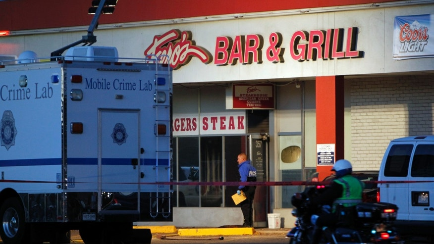 Oct. 17, 2012: Police are pictured at Fero's Bar and Grill in Denver where the bodies of a man and four woman were discovered after firefighters extinguished a fire at the bar early Wednesday morning.
