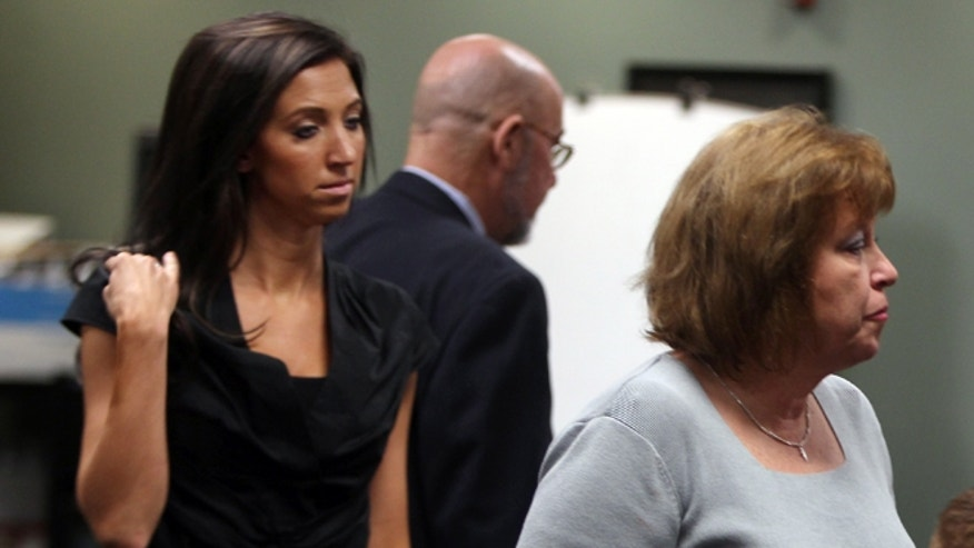 July 30, 2012: Sarah Jones, left, former Dixie Heights High School teacher and Cincinnati Ben-Gal cheerleader, and her mother, Cheryl Jones leave Kenton Circuit Court in Covington, Ky., after a motion hearing on charges against Jones of first degree sexual abuse for allegedly having sexual contact with a 17-year-old student when she was a teacher. (AP)