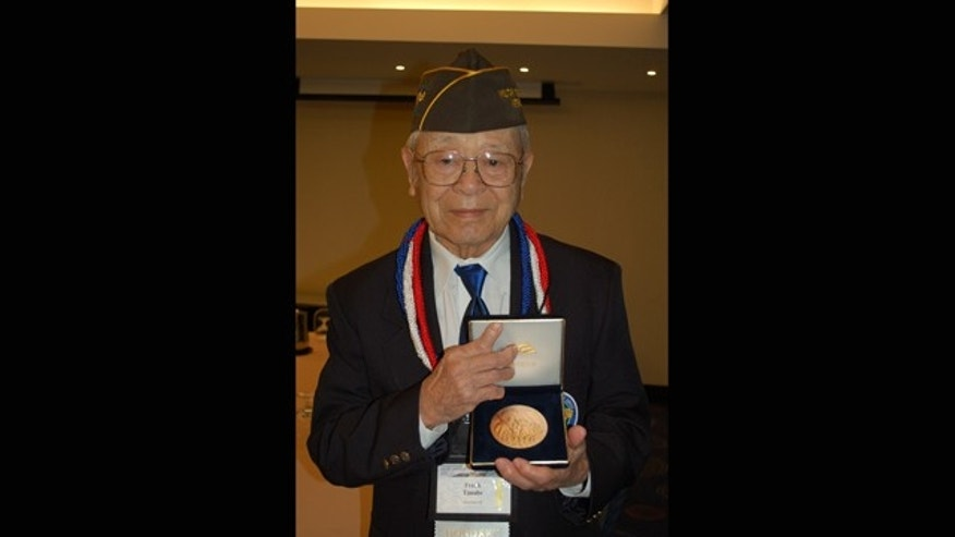 Nov. 2011: Photo provided by Irene Tanabe; Frank Tanabe holds a replica of the Congressional Gold Medal in Washington, D.C., awarded collectively to Japanese-American veterans of World War II, including those who served in his unit, the Military Intelligence Service.