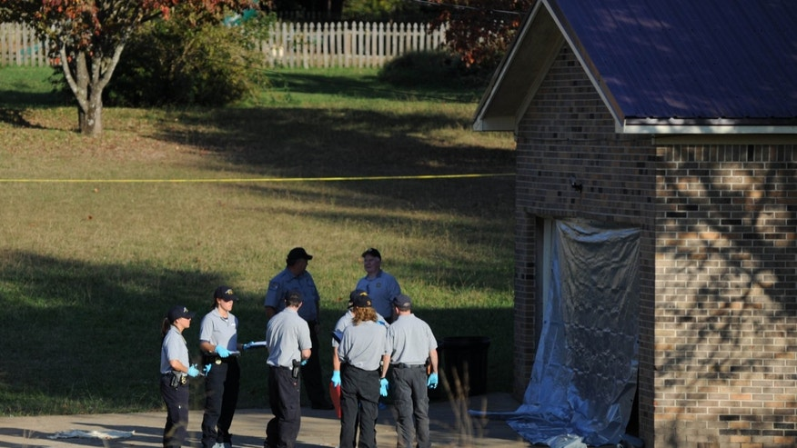 Oct. 22, 2012: Deputies respond to a call at the home just over the state line in Fayetteville, Tenn. The slayings of three women and a toddler at two homes in southern Tennessee may be related to a body found just across the state line in Alabama, authorities said Tuesday.