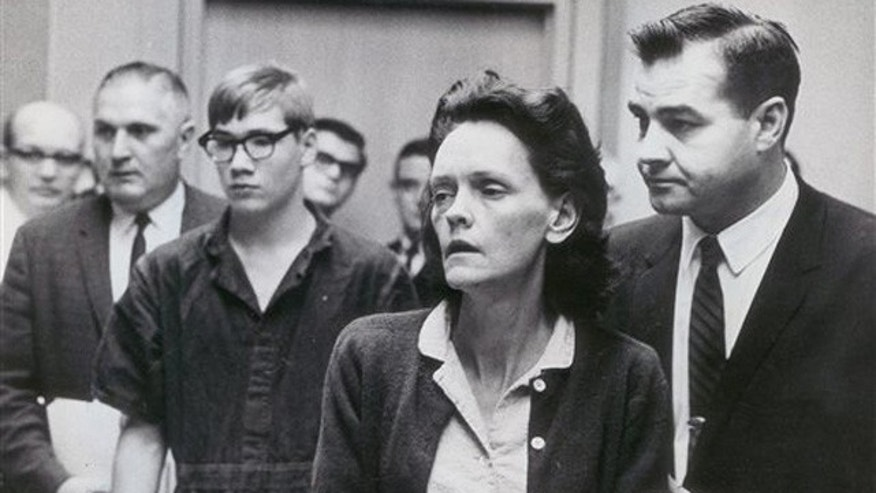 In this Nov. 1, 1965 photo, Gertrude Baniszewski, center right, and Richard Dean Hobbs, 15, center left, listen to Judge Harry Zaklan as he orders them bound over to the Marion County grand jury.